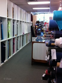 Lots of shelves of fabric at Gala Fabrics in Victoria