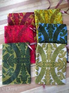 six velvet-like drawstring bags