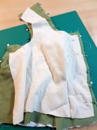 Layering the bodice front for construction - the lining/interlining on the bottom, right side up... the green silk right side down, and the padding-interlining on top