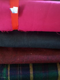 Wools from the 2017 Grandmother's fabric sale - hot pink, charcoal grey, burgundy, and a navy/green/yellow etc plaid.