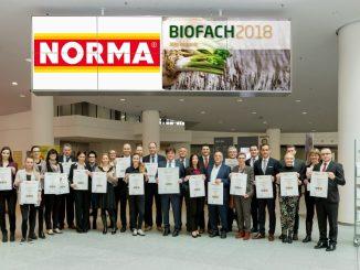 Das NORMA-Management auf der Messe BIOFACH 2018 u.a. mit den Vorständen Gerd Köber (vordere Reihe, sechster von links) sowie Robert Tjón (vordere Reihe, fünfter von rechts.), Foto: NORMA