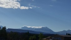Look at the mountain tops for clouds blowing off tops