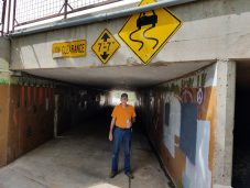 Watch out for crazydriving cars on walking path in the tunnel