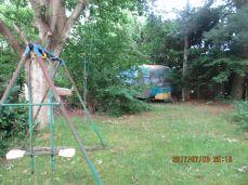 Sneg mig gennem en sommerhushave med minder fra nogens barndom