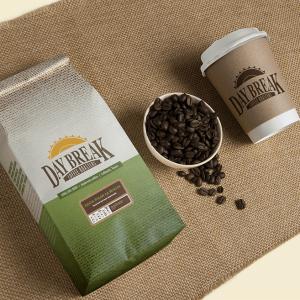 Day Break Costa Rican La Minita coffee bag, beans, and coffee cup