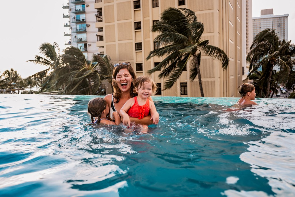 family playing at swell pool alohilani waikiki