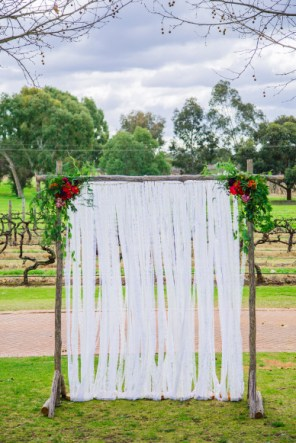 White & Ivory Lace Ribbon Backdrop $55 (Arbor not included). Photo: Mad Love Nation.