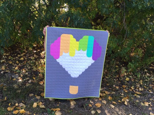 Rainbow hot air balloon baby quilt designed and quilted by Daydreams of Quilts.
