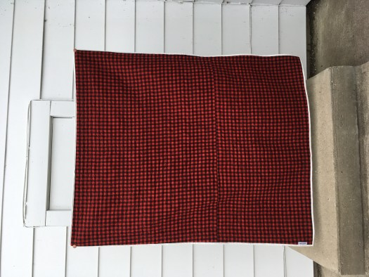 The back of the quilt is red and black buffalo plaid.