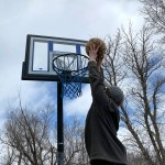 2 p.m. —Jaxon Schrag, 17, dunks the ball to relieve some extra energy from being trapped in the house in Marion, S.D., on April 14, 2020.