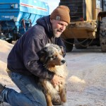 7 p.m. —Chuck Magill takes a short break from feeding cattle to play with the cow dog, Hank, on Magill Farms, near Verona, N.D., on Tuesday, April 14, 2020.