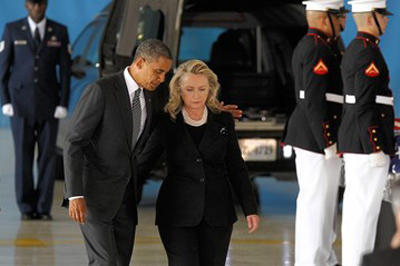 Barack Obama and Hillary Clinton escort the bodies of those killed in Benghazi