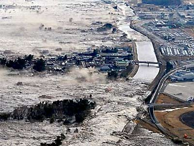 Neptune in Pisces - Tsunami overwhelms Japan