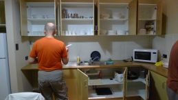Kitchen cupboards, refrigerator, microwave, toaster, etc - and Stephen doing the dishes