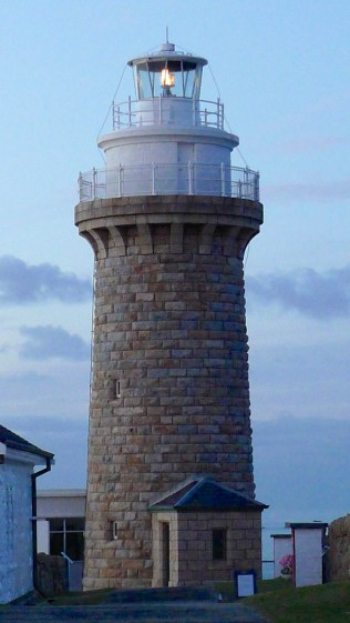 The lighthouse still shines its warning beacon