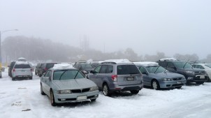 Cars in the top carpark with a decent cap of snow