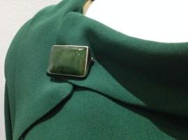 Jean - Close-up of Jean's jade broche
