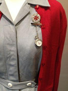 Mattie - Close-up of Mattie's uniform with Ballarat District Nursing Society badge and watch