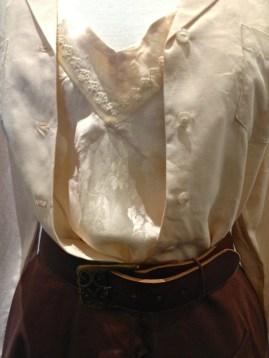 Virginia McKay - Close-up showing floral silk slip & brass buckle detail