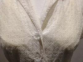 Widgey - Close-up of white cotton lace blouse