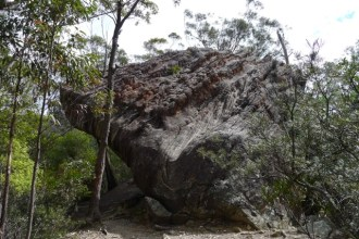 The boulders are much more erroded on their exposed side