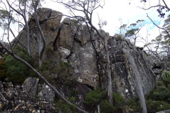 Magnificent and enormous boulders form cliffs on one side of a boulder field