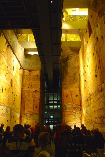 MONA's subterranean entrance-exit from the Void Bar, showing off the Jurassic sandstone, raw-finish commercial construction, and the glass elevator
