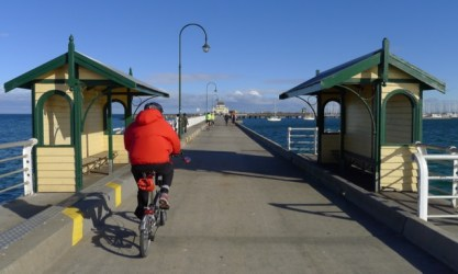 Siewmee riding by sheltered seats roughly halfway along the St Kilda Pier
