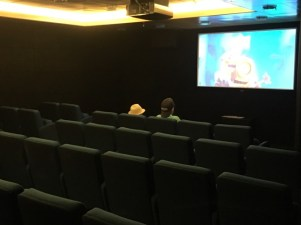 Right-side cinema has blue seats