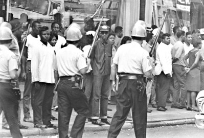 Dayton Police patrol the streets in the aftermath of a riot