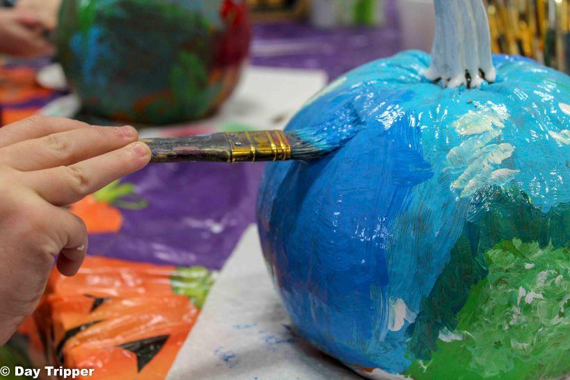 Painting a pumpkin at enchanted acres pumpkin patch ia