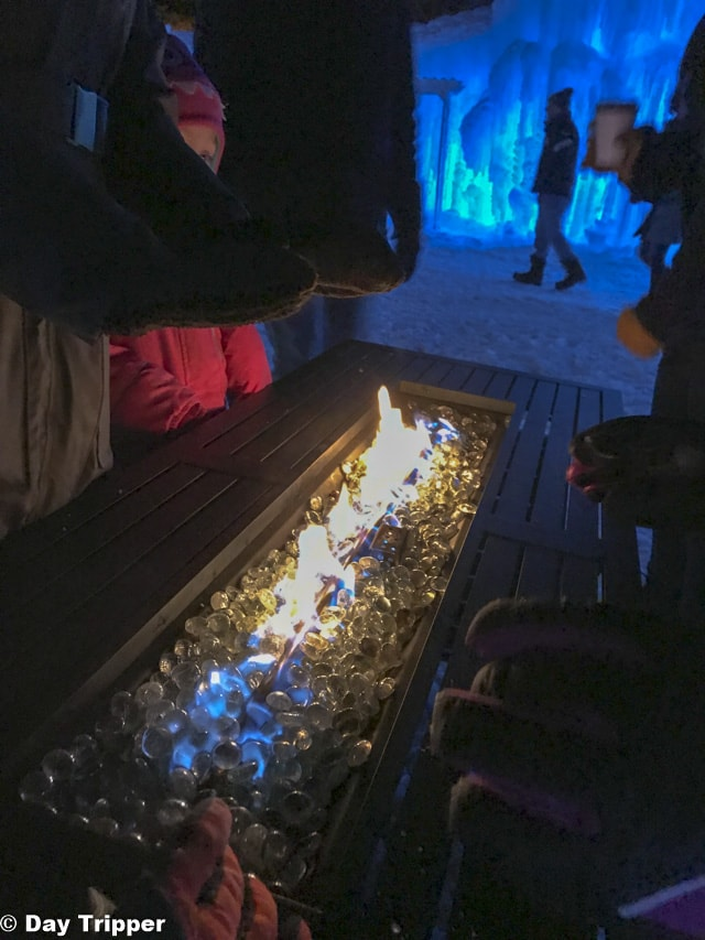 warming up at a fire