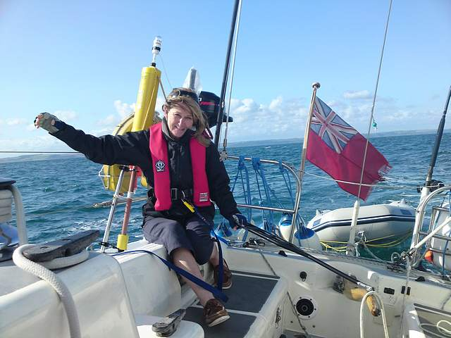 Marion at the helm cruising Devon,  Dartmouth to Salcombe to Torquay.