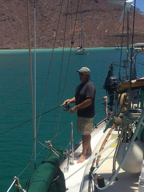 Captain Dan doing a little fishing from the boat. Sad to say the waters are still a bit cool to catch much.