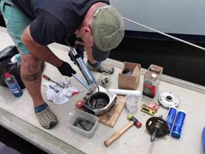 Dan injecting grease into windlass