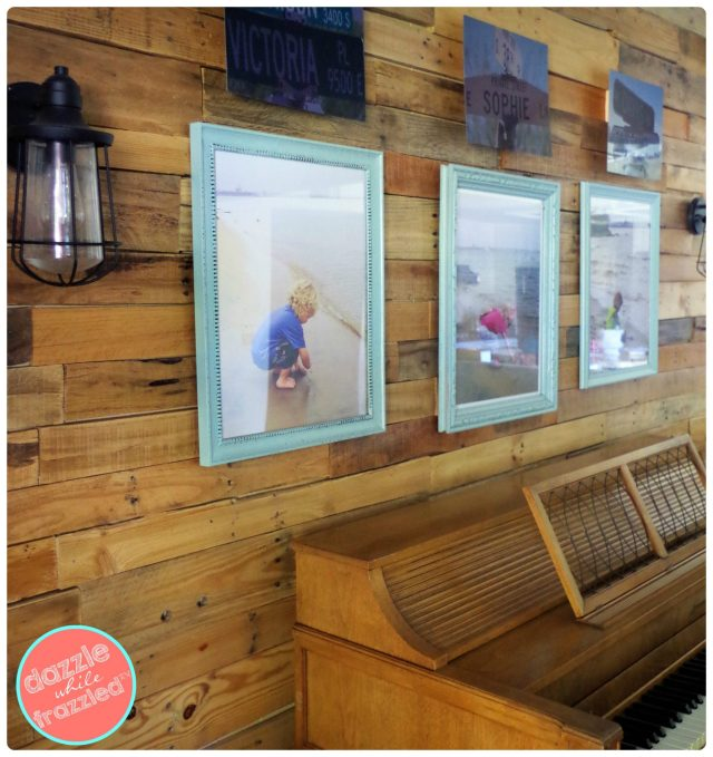Update a wall in your home with DIY wood pallet wall decorated with personal photos and name signs.