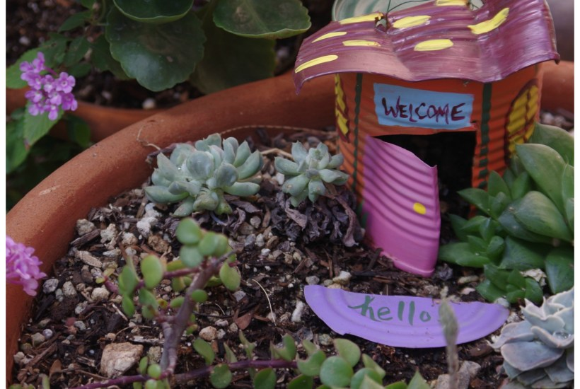 How to make a tin can fairy garden house with (clean) tin cans and craft patio outdoor paints.