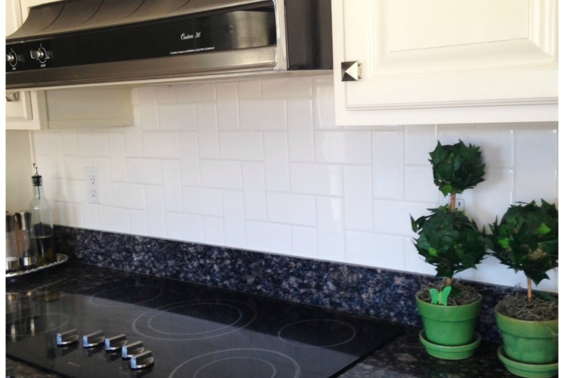 Unique, attractive, affordable white subway stair step pattern in kitchen backsplash.