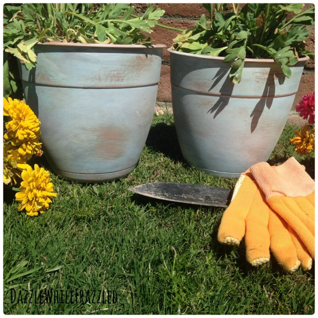 Make your flower pots look old with watered down paint, etching primer and sanding block.
