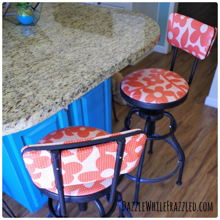 DIY reupholster kitchen barstools using laminated cotton fabric and foam padding.