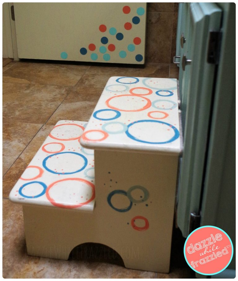 Fun polka dot kids step stool makeover with paint and circle stencil