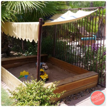 How to build a kids backyard wooden sandbox from redwood fence posts. Use TYLENOL® 8 HR Muscle Aches & Pain for weekend warrior projects. | DazzleWhileFrazzled.com