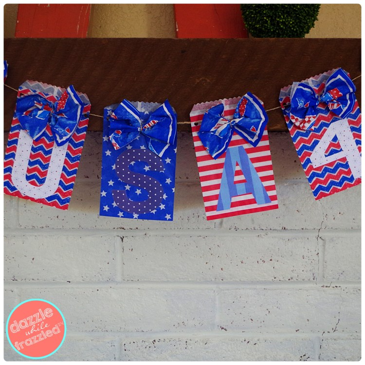 Make a USA garland using paper treat bags and cocktail napkins.