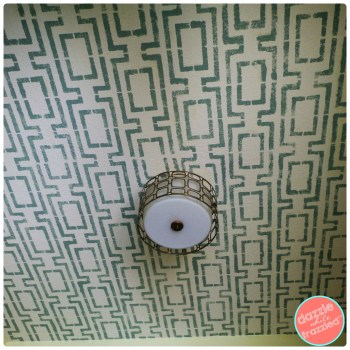 Use paint and a large stencil to update a boring white ceiling