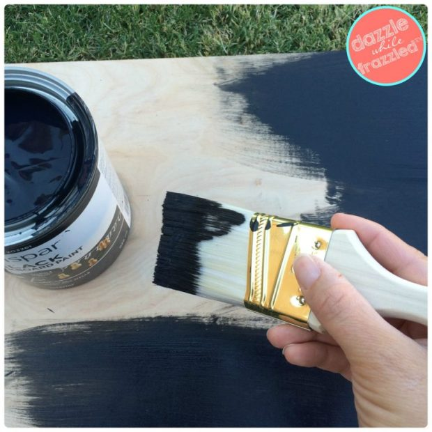 How to build an outdoor chalkboard for the kids to hang over a fence using scrap plywood | Dazzle While Frazzled.com