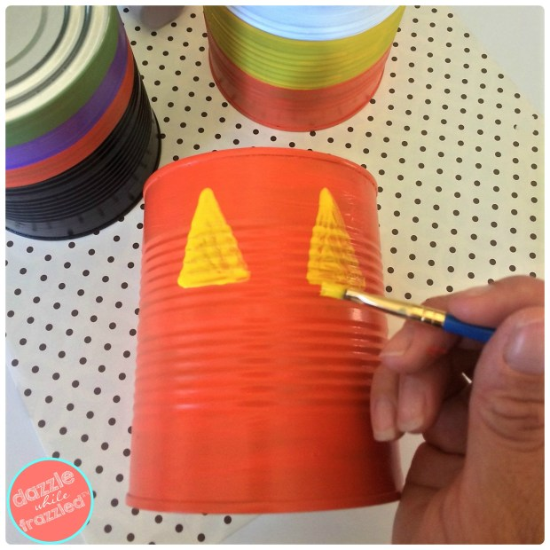 Halloween tin can treat holders using tin cans and craft acrylic paints | DazzleWhileFrazzled.com