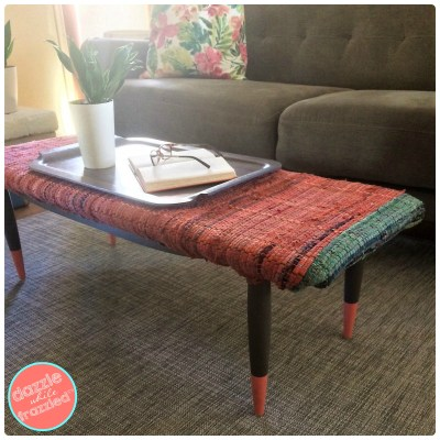 Cover a thrift store coffee table with a flat weave rug for custom coffee table bench   DazzleWhileFrazzled.com