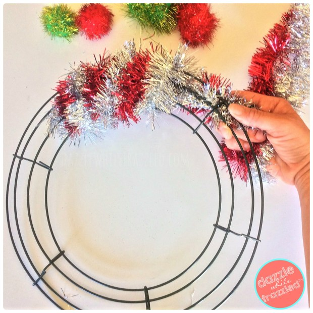 Wrap a wreath form with tinsel garland for a DIY Retro Tinsel Garland Christmas Wreath