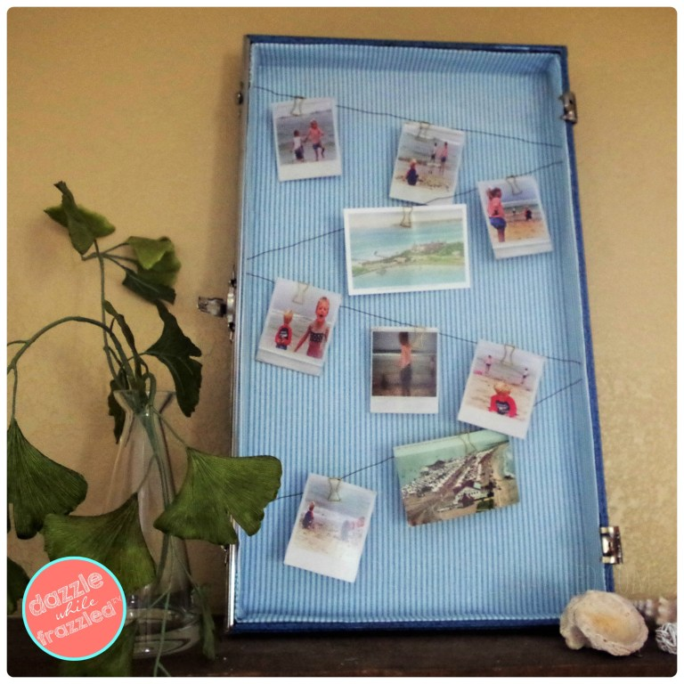 Retro home decor using vintage suitcase as a photo display
