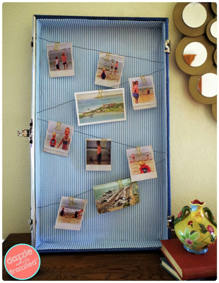 Display travel memories and photos in vintage suitcase. How to re-purpose old luggage as DIY home decor.